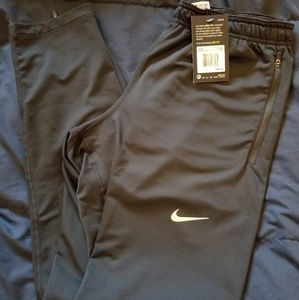 Nike slim athletic pants men's M NEW